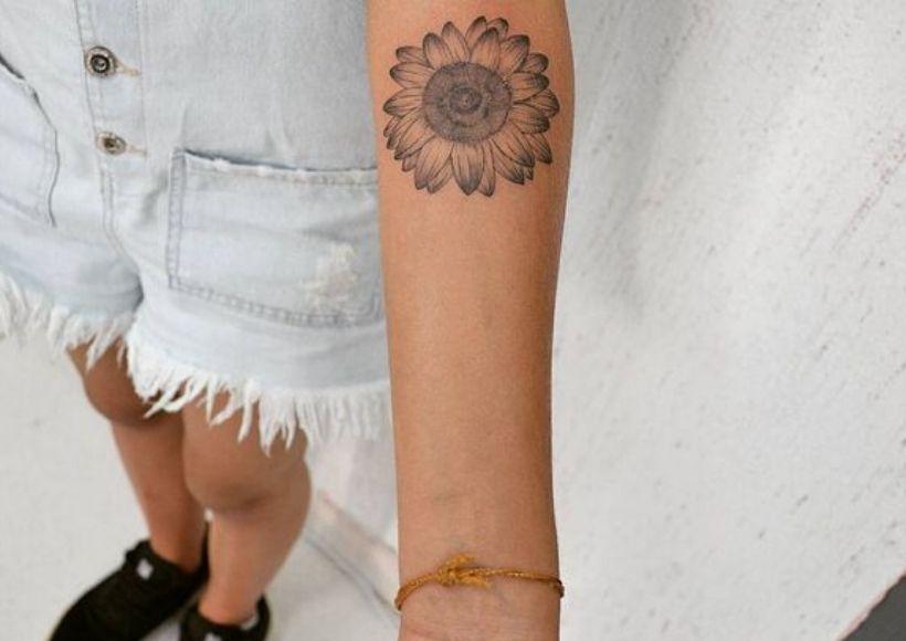 Small Sunflower Tattoo Near The Inner Elbow