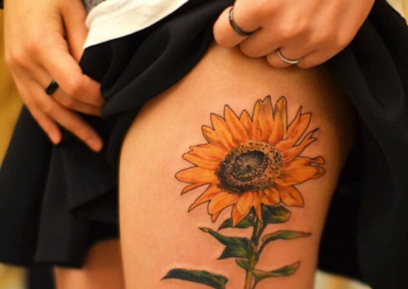 Sunflower Tattoo On The Thigh For Girls